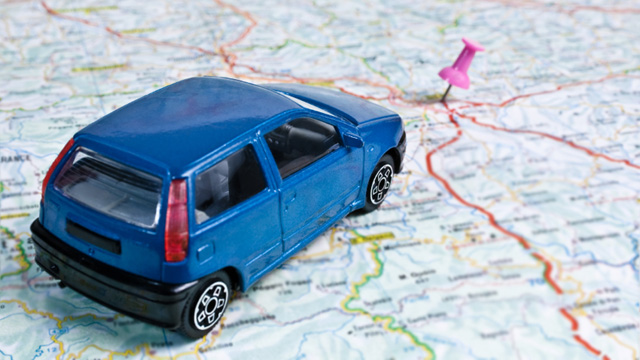 Road-trip-vacation--car-on-map-jpg
